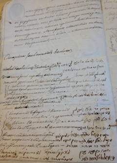 Archived document signed by residents of Schedrin testifying that the Tzemach Tzedek had setteled them on his land, rent free, and provided for their agricultural needs.