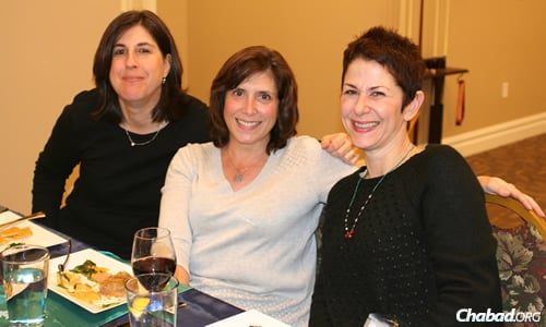 Julie Zorn, Sue Hodess and Debby Suris enjoy a scrumptious dinner.