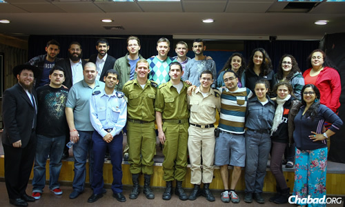All together now with members of the Israel Defense Force. Rabbi Mendy Wilansky is standing in the bottom row, left; Rabbi Yehoshua Soudakoff is in the top row, second from left.