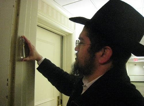 The rabbi also affixed a mezuzah outside the door of Imich's apartment, where the elderly man has lived since 1965. (Photo: ©Beth Sarafraz)