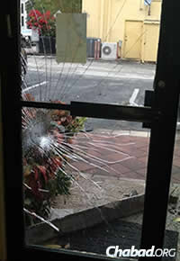 In a rare act of vandalism, the rabbi's concrete parking slab was hurled through a glass window of the center two days before the concert, which caused even more people to come in a show of support.
