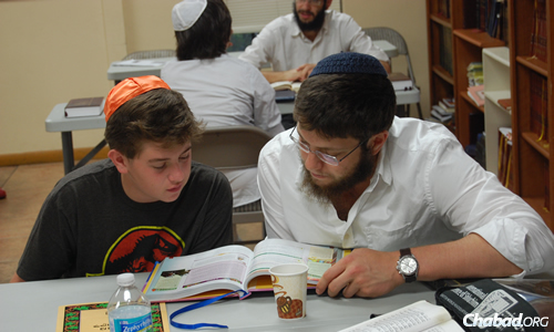 """The Chabad center's novel Hebrew-school program includes the """"My Big Chaver"""" (""""My Big Friend"""") one-on-one study program."""