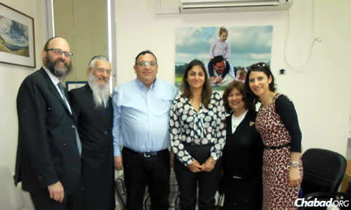 In Israel recently at the education ministry: from left, Joe Nahmad High School director Rabbi Igal Hazan; school dean Rabbi Avraham Hazan; Israel's Minister of Education Shai Piron; director-general of the education ministry Michal Cohen; school principal Rivka Hazan; and school coordinator Hamutal Wolkowiez.