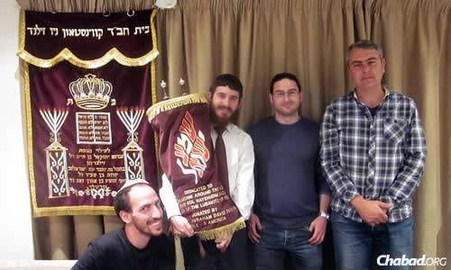 By coincidence, the mantel of a brand-new Torah scroll on loan to Chabad of New Zealand in Auckland just happens to match the color of the shul's redesigned cover for the aron kodesh, the Holy Ark.