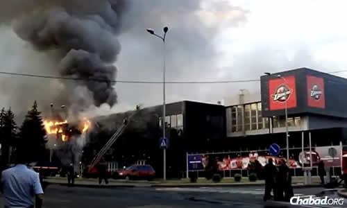 A sports center in Donetsk was set ablaze in fighting between Ukranian troops and pro-Russian separatists.