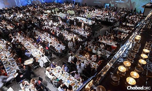 Guests at the record-breaking Shabbat meal at their seats just prior to the onset of the Jewish Sabbath.