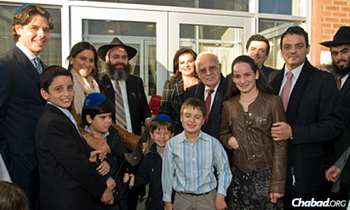 Moise and Chella Safra, center, with family members at the dedication of the Bait Ezra Community Center, Chabad of the Town in Montreal, Canada. It was the first institution named by Safra for his father-in-law, Ezra Cohen.