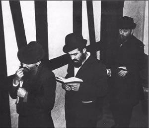 Chassidim waiting outside the Rebbe's study for yechidut, circa 1970