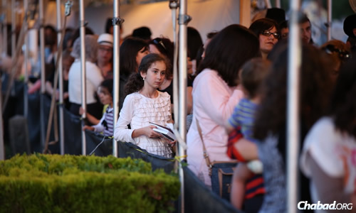 Women and girls wait in line to visit the Rebbe's resting place. (File photo: Chaim Perl)