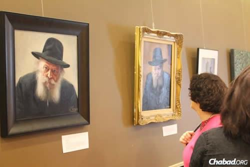 The show includes a range of paintings and illustrations of the Rebbe in different styles.