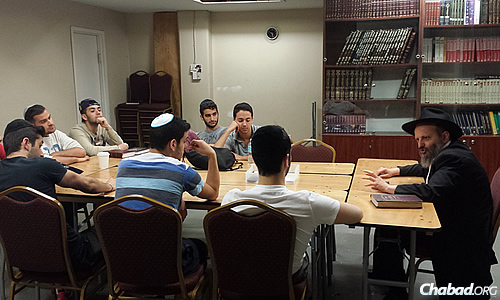 Students learn in a class taught by Rabbi Naftoli Perlstein, director of the Chabad Chai Center in Montreal.