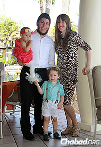 The Blasbergs with their children, Menny, 3, and Leah, 1