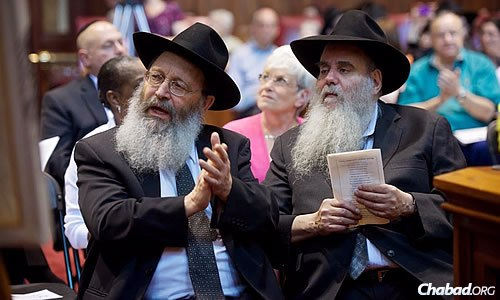 Rabbi Yosef Gopin, co-director of the Chabad House of Greater Hartford in West Hartford, Conn., and Rabbi Moshe Kotlarsky, vice chairman of Merkos L'Inyonei Chinuch, the educational arm of Chabad-Lubavitch, take in the program.