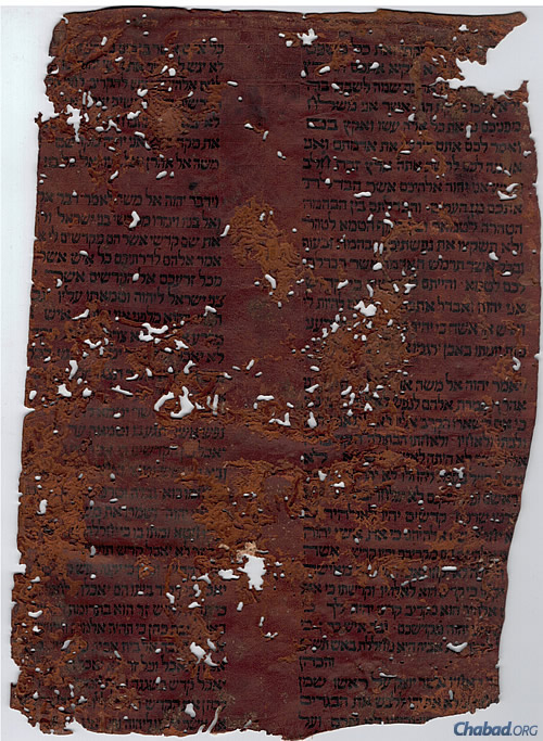 LEAF FROM ANTIQUE SEFER TORAH ON PARCHMENT