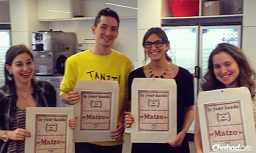 Giving out matzah at BuzzFeed in New York City as part of #openShabbat's communal work for Jews in technology and media