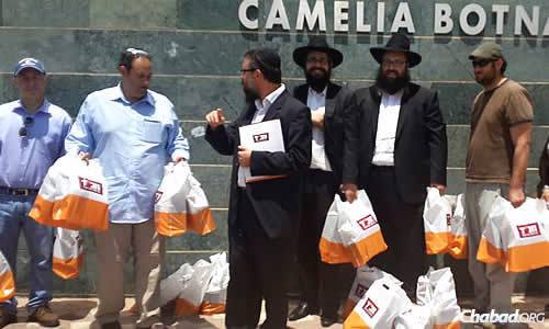 The group came with care packages from home and bought more goods for people once in Israel. When the three-day mission ended, they said they may have gotten more out of it than the recipients.
