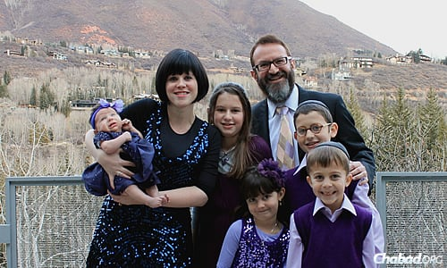 Rabbi Mendel and Leiba Mintz and their children in a photo taken about a year-and-a-half ago. In July, the family welcomed a new baby girl.
