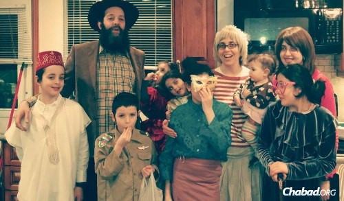The Banon children (pictured with their parents in Purim costumes) are a major attraction, according to students who have gotten to know them.