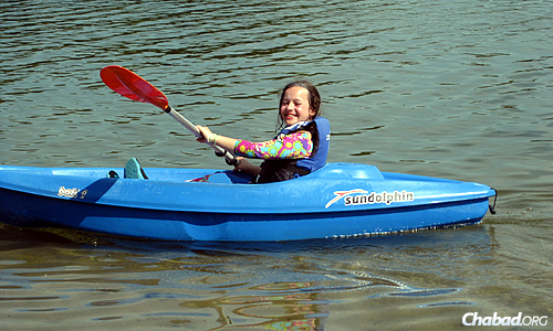 Campers say they enjoy the boats—in this case, the kayaks—that are part of a Camp Gan Israel eight-day overnight experience in Wisconsin.