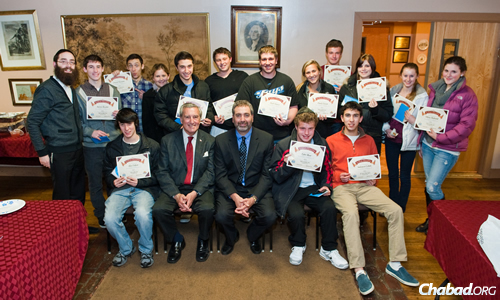 Teens with their course completion certificates at Chabad of the Main Line, outside Philadelphia. With them is Rabbi Mendy Cohen, standing, far left.