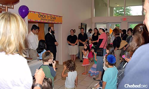 Chabad of Georgia associate director Rabbi Isser New speaks with students and parents of the Chaya Mushka Children's House (CMCH) in 2010, the year the first- through sixth-grade Montessori-style elementary school first started.