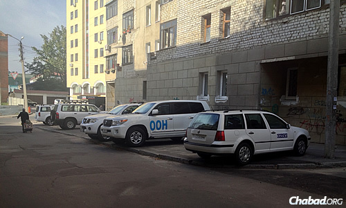 A large group of Organization for Security and Cooperation in Europe (OSCE) officials—their identifiable trucks parked in town—was observed recently in Kharkov.