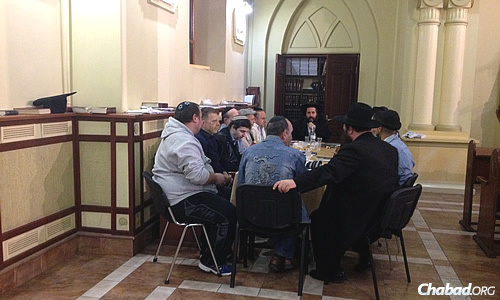 """A late-night """"farbrengen,"""" or informal Chabad gathering, at the central synagogue in Kharkov prior to Selichot services on the Saturday night before Rosh Hashanah."""