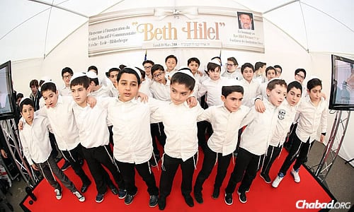 Boys sing at the grand opening of a new Sinai School campus—the Beth Hillel Campus—in Levallois, in the northwestern suburbs of Paris, in March of this year. (Benams Photo)