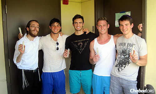 Rabbi Yossi Matusof, co-director of Chabad Student Center of Claremont, with AEPi members, from left, Mike Levy, Dylan Saffer, Bryan Turkel and Elliott Hamilton, all of whom hung mezuzahs after one was ripped down at Claremont McKenna College during the High Holidays.