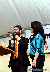 Rabbi Yosef and Chani Konikov addressed the audience at last month's groundbreaking event. (Photo: Sonacity Productions)