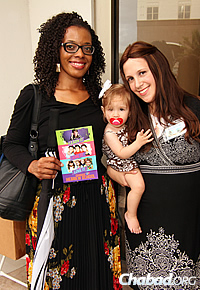 Teachers at the Chai Preschool Alexis Lewis, left, and Dini Druk, with her baby daughter. (Photo: Sonacity Productions)