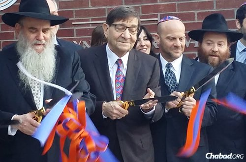 Rabbi Moshe Kotlarsky, vice-chairman of Merkos L'Inyonei Chinuch, the educational arm of Chabad-Lubavitch, Fred Levin, Martin Levin, and Rabbi Berl Goldman, at the ribbon cutting ceremony in February at the dedication of The Tabacinic Campus and Marilyn Kapner Levin Center for Jewish Life and Learning at the University of Florida at Gainesville.