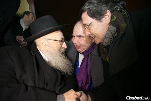 With dignitaries at last year's annual grand Chanukah menorah-lighting celebration near the Eiffel Tower in Paris.
