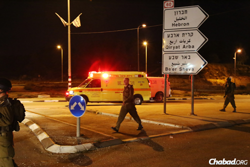 Israeli soldiers seen near an ambulance evacuating those who were injured when a Palestinian driver rammed into the soldiers near the West Bank village of Al Aroub, near the Gush Etzion junction outside of Jerusalem. (Photo: Gershon Elinson/Flash90)