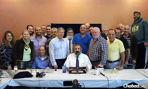 A core group of 20 to 25 students have been coming daily to Chabad of the Valley in Encino, Calif., to study the Mishneh Torah with Rabbi Yehoshua B. Gordon. Regular attendee Daniel Aharonoff, seated at left, persuaded the rabbi to allow a camera into the room.