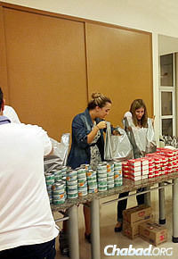 Volunteers pack bags of Passover food for Brazilian Jews in need.