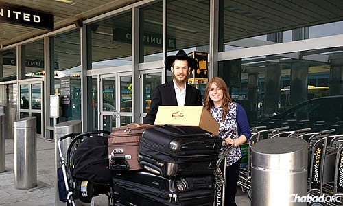 The Kesselmans at New York's LaGuardia Airport, ready to leave for a new home in Texas.