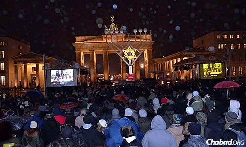 Thousands crowd near a new 30-foot menorah—the tallest in Europe—inaugurated last year at the Brandenburg Gate in Berlin, Germany.