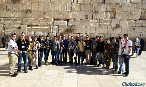 A group of students from the University of Central Florida at the Western Wall in Jerusalem, as part of a Taglit-Birthright Israel trip, accompanied by Chabad Rabbi Chaim Lipskier.