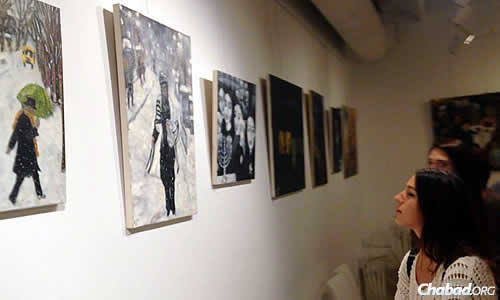 Visitors take a look at artwork reflecting Jewish life year-round.