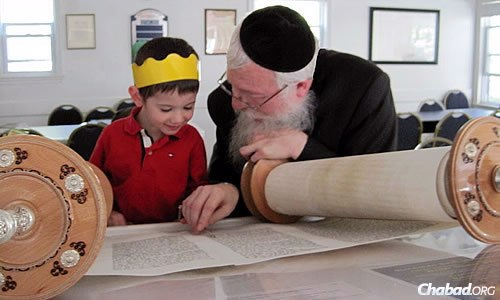 Lisbon works one-on-one with a student as part of a curriculum that emphasizes the basics of Jewish education and the Hebrew language.