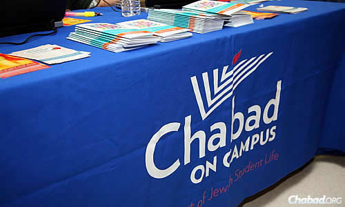 A table replete with information about Chabad on Campus on display at an the annual international Shabbaton, held in New York City and attended by 1,000 or more students each year. (Photo: Bentzi Sasson)