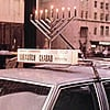 Four Decades of Car Menorahs Lighting the Way