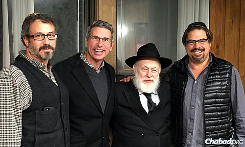 At the recent International Conference of Chabad emissaries in New York: from left, Montana residents Stu Binenstock, Dr. Mick Lifson and Larry Pearson, with Rabbi Yehuda Krinsky, chairman of Merkos L'Inyonei Chinuch, the educational arm of the Chabad-Lubavitch movement. Lifson studied a chapter a day of Mishneh Torah, completing the cycle in three years.