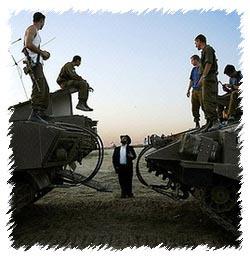 A Lubavitcher speaks to Israeli soldiers near Melfasim, Israel. Photo: AFP/David Furst