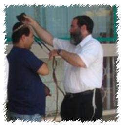 Donning Tefillin with a resident of the Nothern Israeli town Akko
