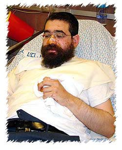 Rabbi Chaim Kaplan, Chabad-Lubavitch emissary in Safed, Israel, recovers from shrapnel wounds that landed a meter from his car