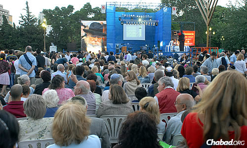 A more contemporary crowd gathers for the lighting, which takes place in the summertime in Argentina.