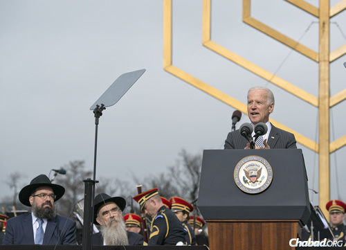U.S. Vice President Joe Biden addresses the crowd at the National Menorah lighting, as Rabbi Levi Shemtov, left, and Rabbi Abraham Shemtov look on. (Photo: Ron Sachs)