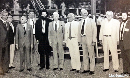 Rabbi Tzvi Grunblatt, fifth from left, with communal leaders at Chanukah 1984-1985, a year after the director of Chabad Lubavitch of Argentina erected a public menorah in Buenos Aires to a concerned Jewish community.